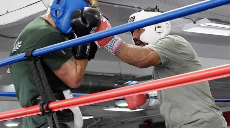 Boxing Coach Joe Sparring with His Amateur Fighters