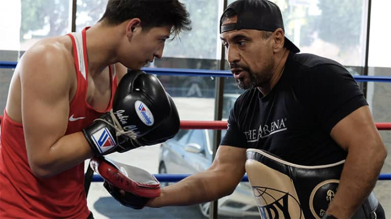 Coach Joe Vargas Working with Young Boxer Jabin Chollet